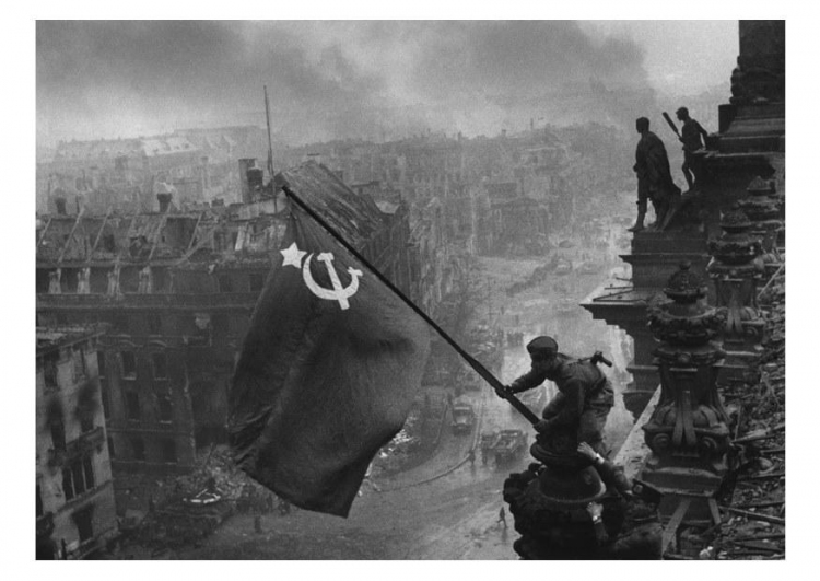 The Soviet flag flies over the Berlin Reichstag at the end of WWII
